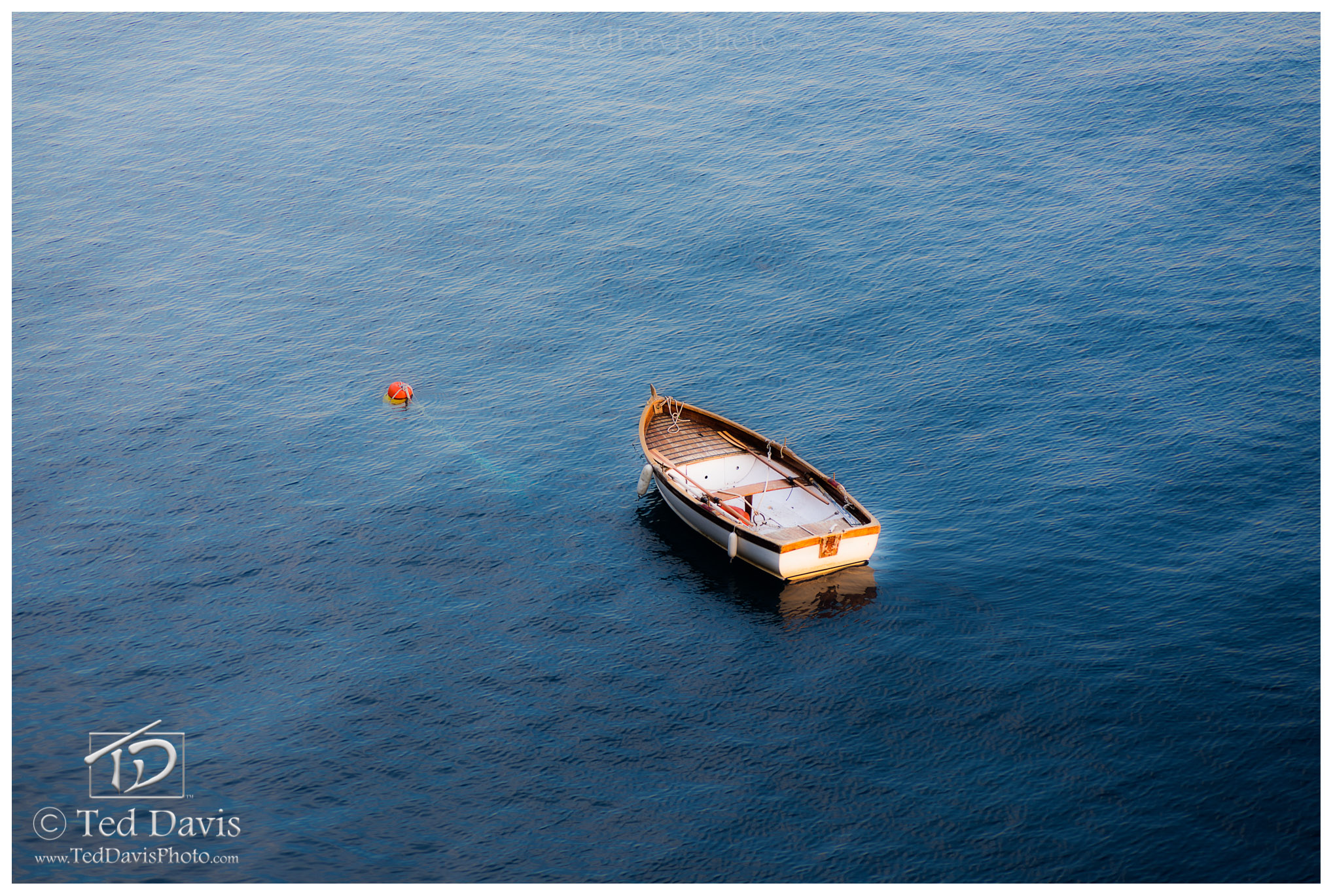 Limited Edition of 100 A dinghy rolled in the calm swells of the Mediterranean. On a cliff above the harbor, I was relaxing with...